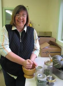 Randi Embree prepares a mixture.