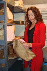 Dori Elliot sorts Silverton Police Department evidence.